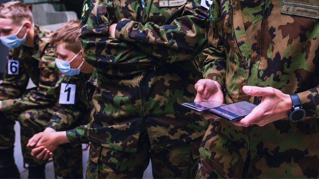 Picture of soldiers using contact tracing app